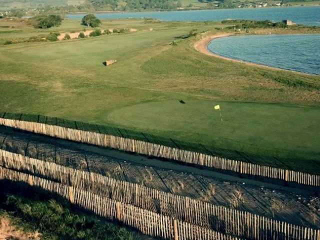 Aerial view of 6th green with lagoon