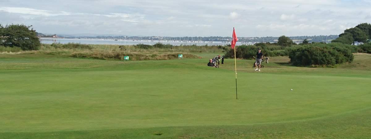 Warren 10th green with Exe estuary behind